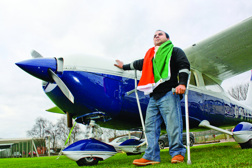 Gautam poses next to an aircraft, a part of the fleet at his not for profit company Freedom in the Air.