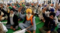 Farmers shout slogans at the demonstration site during the ongoing farmer protest